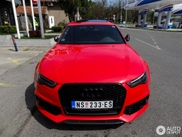 Red Audi RS6 Avant betrays its sportiness