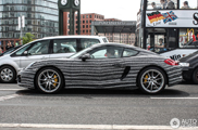 This Porsche Cayman S has a psychedelic wrap