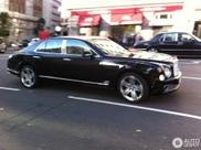 British couple rolls stately trhough London