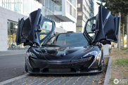 A happy kid gets a ride in this McLaren P1