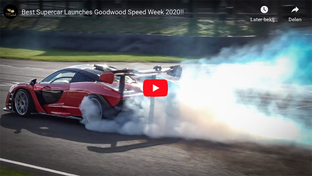 Supercars doing burnouts during Goodwood Speedweek